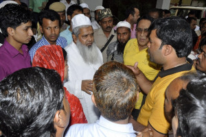 AIUDF chief Badruddin Ajmal with ticket seekers. Credit: PTI