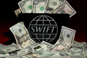 The SWIFT logo is pictured in this photo illustration taken April 26, 2016. Credit: Reuters/Carlo Allegri/Illustration/File Photo