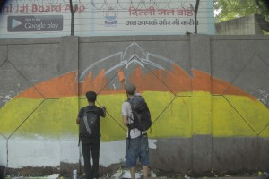 Artists Akhlaq Ahmad and Swen Simon starting on their mural in Shahdara for the 'Delhi, I Love You' project. Credit: Delhi, I Love You