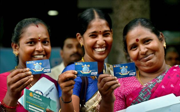 Women holding their Jan Dhan account cards. Credit: PTI
