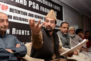 Chairman of the moderate faction of the Hurriyat Conference Mirwaiz Umar Farooq along with other leaders at a press conference after he was released from house detention at Hurriyat Headquarters in Srinagar on Monday. Credit: PTI