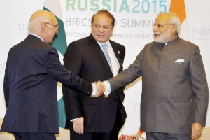 Pakistan Prime Minister Nawaz Sharif introduces his advisor Sartaj Aziz to Prime Minister Narendra Modi during a meeting at UFA in Russia. Credit: PTI/ Manvender Vashist