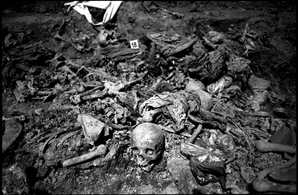 A forensic expert searches for remains of Bosnian Muslims in a mass grave near Srebrenica July 10, 2007. Credit: Reuters/Damir Sagolj.