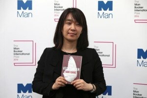 "South Korean author Han Kang poses with her novel ""The Vegetarian"", which is nominated for the Man Booker International Prize, during a media event in London, Britain May 15, 2016. Credit: Reuters/Neil Hall/File Photo."