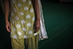 A 16-year-old girl with her hand decorated with henna stands inside a protection home on the outskirts of New Delhi November 9, 2012. Credit: REUTERS/Mansi Thapliyal/Files