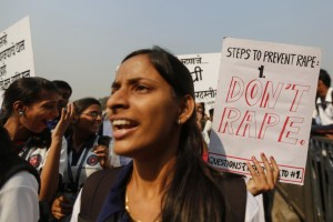 Students from various colleges holding placards as they shout slogans during a rally against gender discrimination and violence toward women in Mumbai on December 10, 2014. Credit: Shailesh Andrade/Reuters.