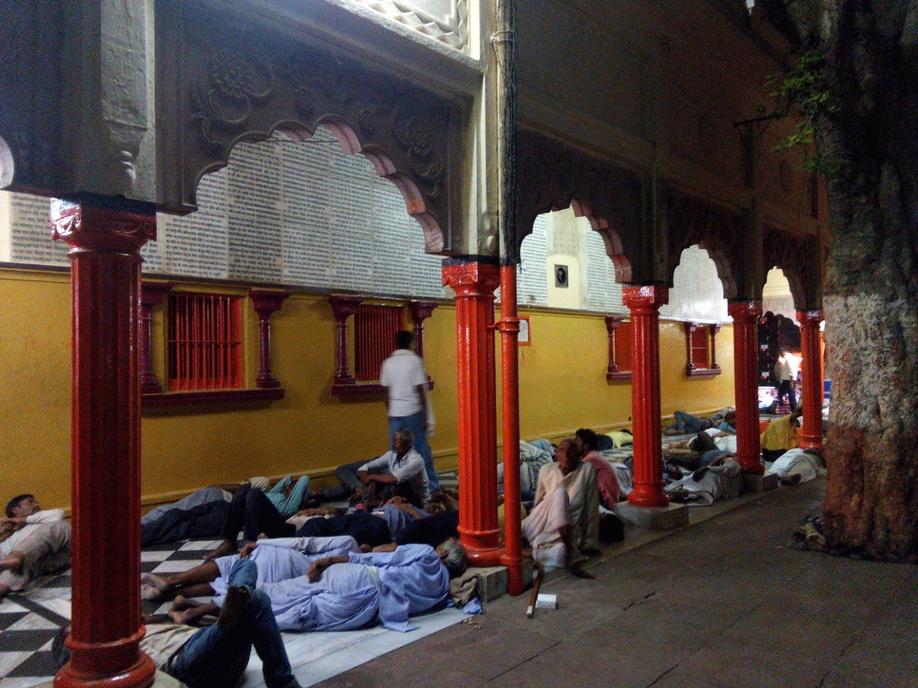 People napping along one of the temple verandahs, at 3 am on April 29.