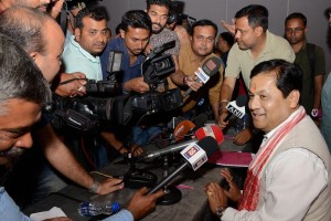 Union minister and BJP's Assam chief ministerial candidate Sarbananda Sonowal talking to media persons in Guwahati on Tuesday. Credit: PTI