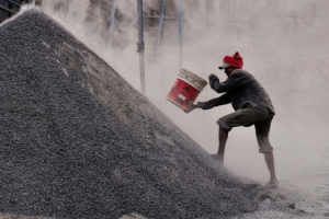 Worker at a stone crushing factory. Credit: Debdatta Chakraborty, UCL News/Flickr CC BY-NC-ND 2.0