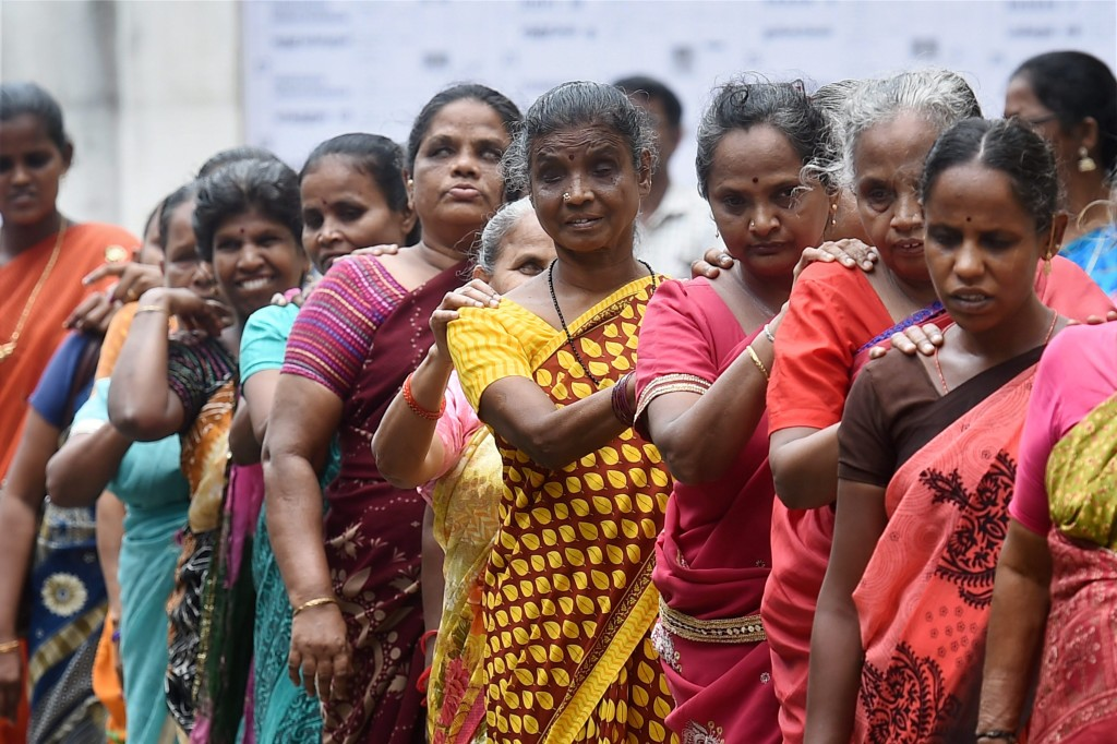 Visually impaired women coming out of a polling booth after casting their votes for in Tamil Nadu. Credit: PTI