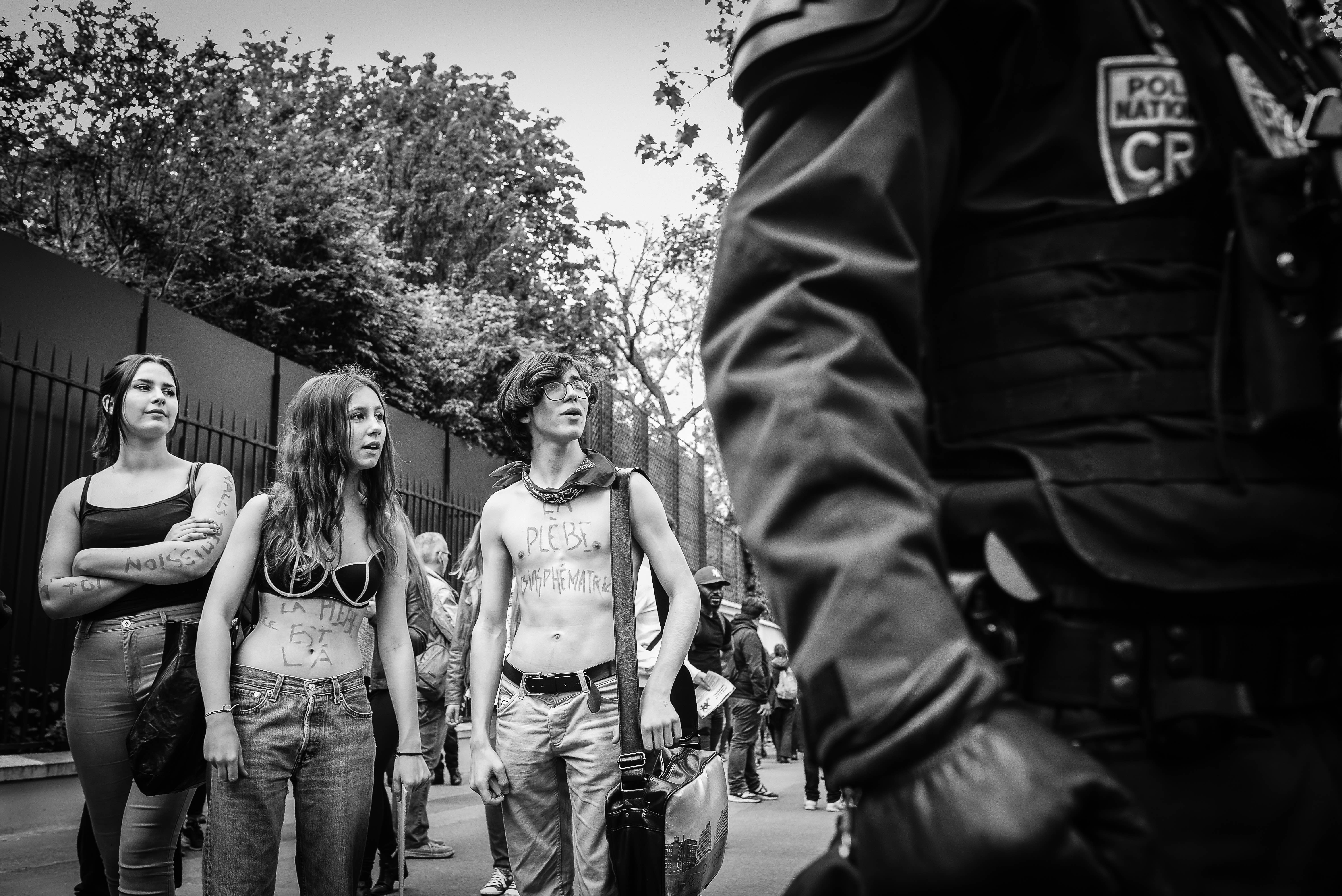 Lycéens (high school students) taking part in a demonstration against the Loi travail, Paris, 17 May 2016. The writings on their bodies describe them as blaspheming plebeians. Credit: Laurent Gayer