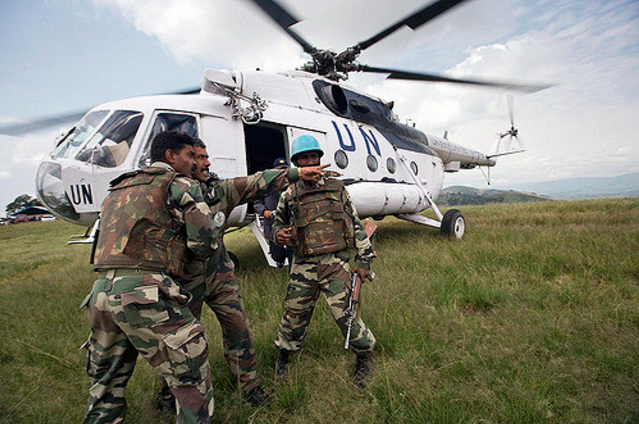 Members of the Indian battalion of the United Nations Organization in the Democratic Republic of the Congo (MONUC) secure the area upon arrival of a delegation from Goma. 30 Sep 2008. Credit: UN Photo by Marie Frechon.