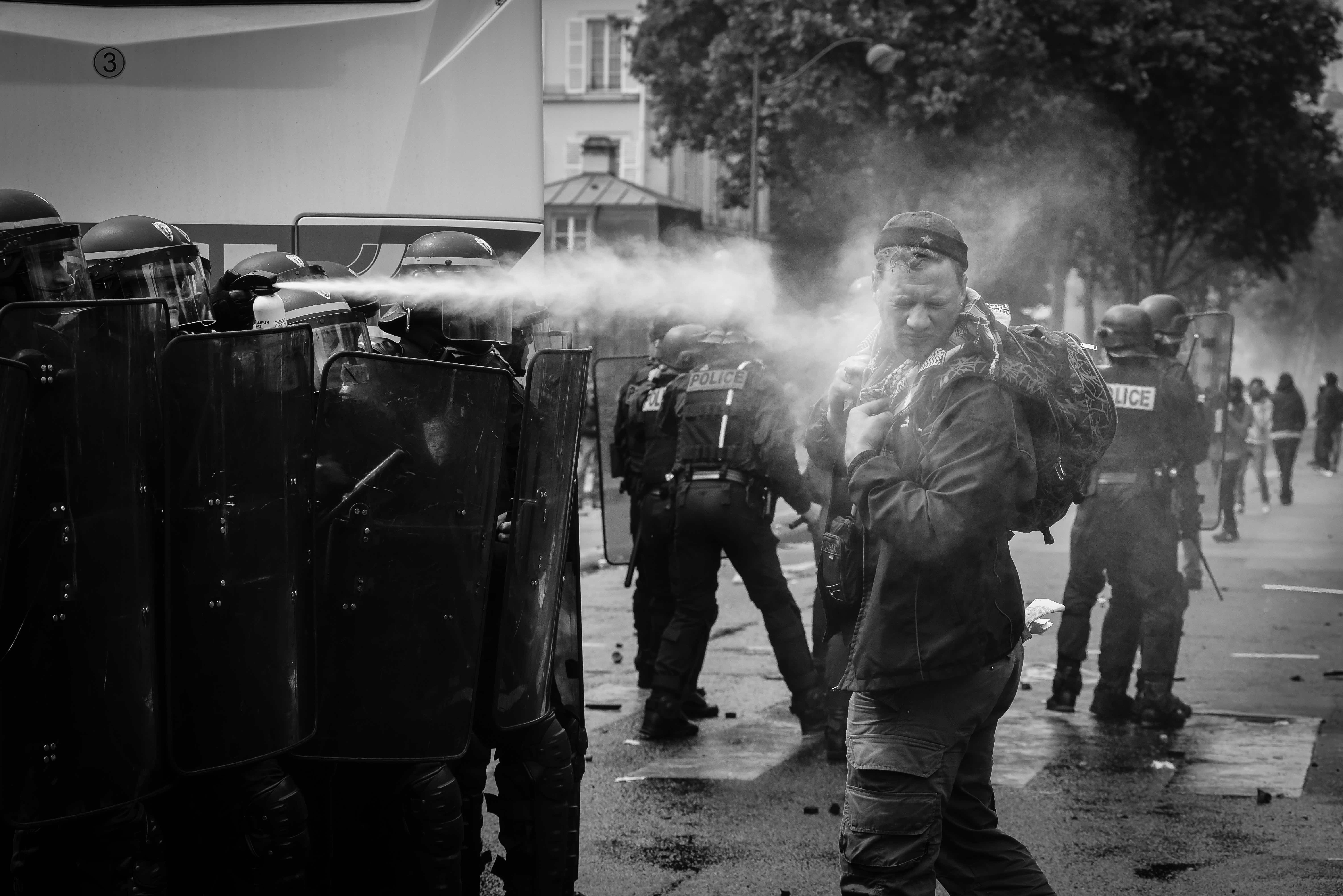 The riot police using tear gas against a demonstrator. Paris, 14 June 2016