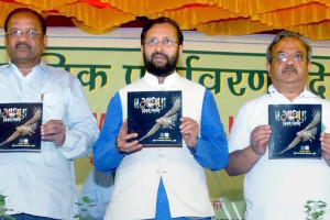"Mumbai: Minister of State for Environment, Forest and Climate Change (Independent Charge), Prakash Javadekar releasing a coffee table book on ""Gatha Nisargachi"", by the Forests Department (Govt. of Maharashtra, during the ""World Environment Day"" celebrations, in Mumbai on Sunday. PTI Photo (PTI6_5_2016_000169B)"