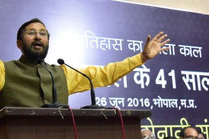 Bhopal: Union Environment Minister Prakash Javadekar addressing a seminar on 41st anniversary of the Emergency, organised by Loktantra Sainani Sangh at State BJP Headquarter in Bhopal on Sunday. Madhya Pradesh Chief Minister Shivraj Singh Chouhan with Misa detainees were also present on this occasion.    PTI Photo (PTI6_26_2016_000179A)