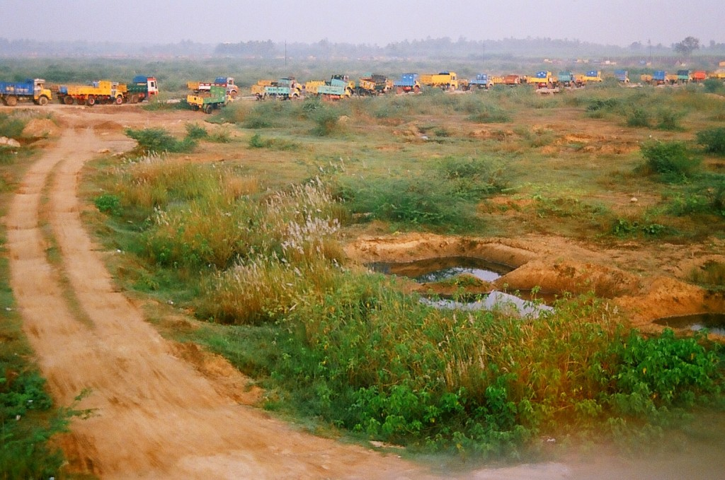 Queue of trucks waiting to be loaded with mined sand. Kanchipuram, Tamil Nadu.