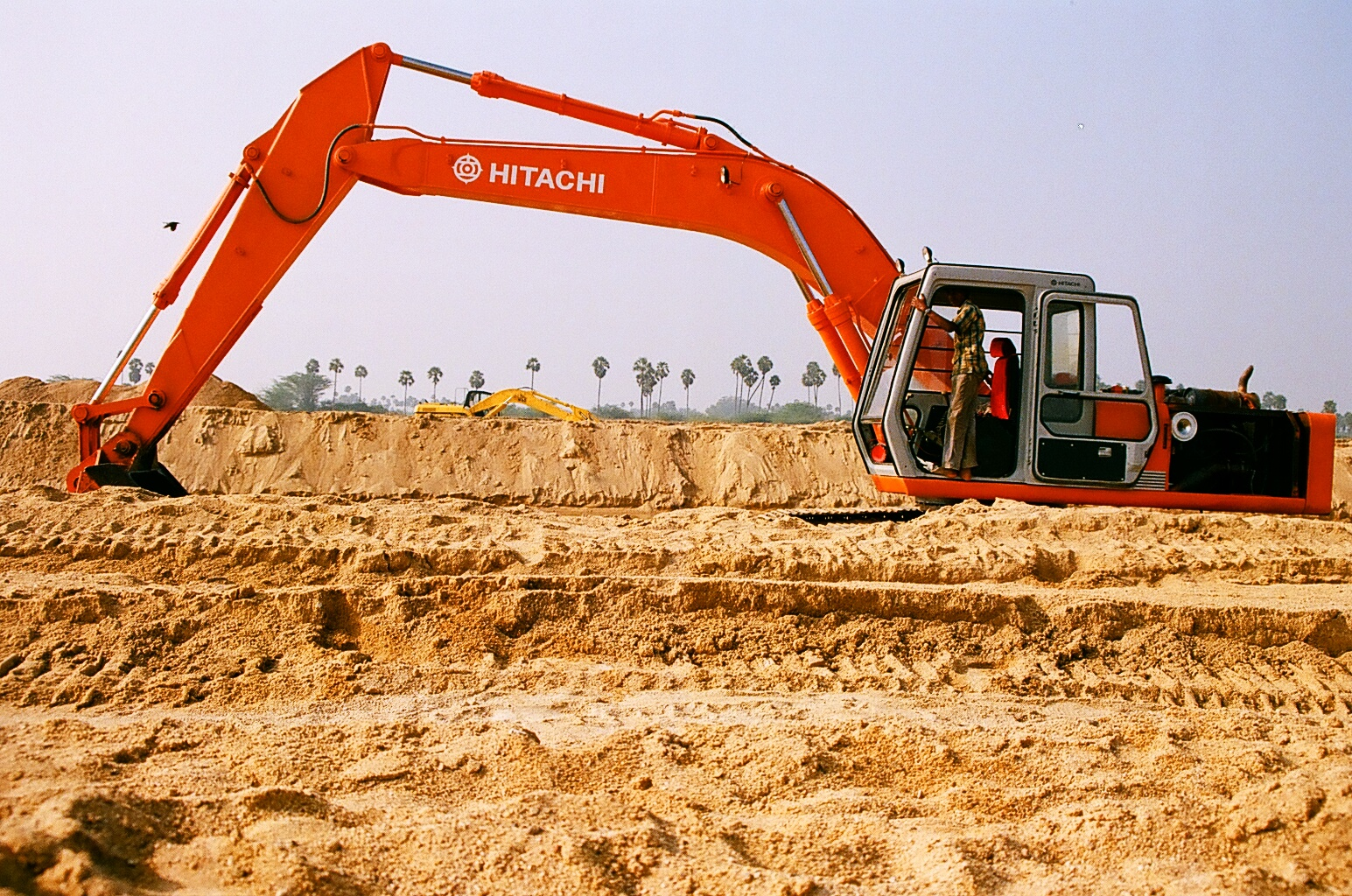 A view of the earth mover used to load sand. Kanchipuram, Tamil Nadu.
