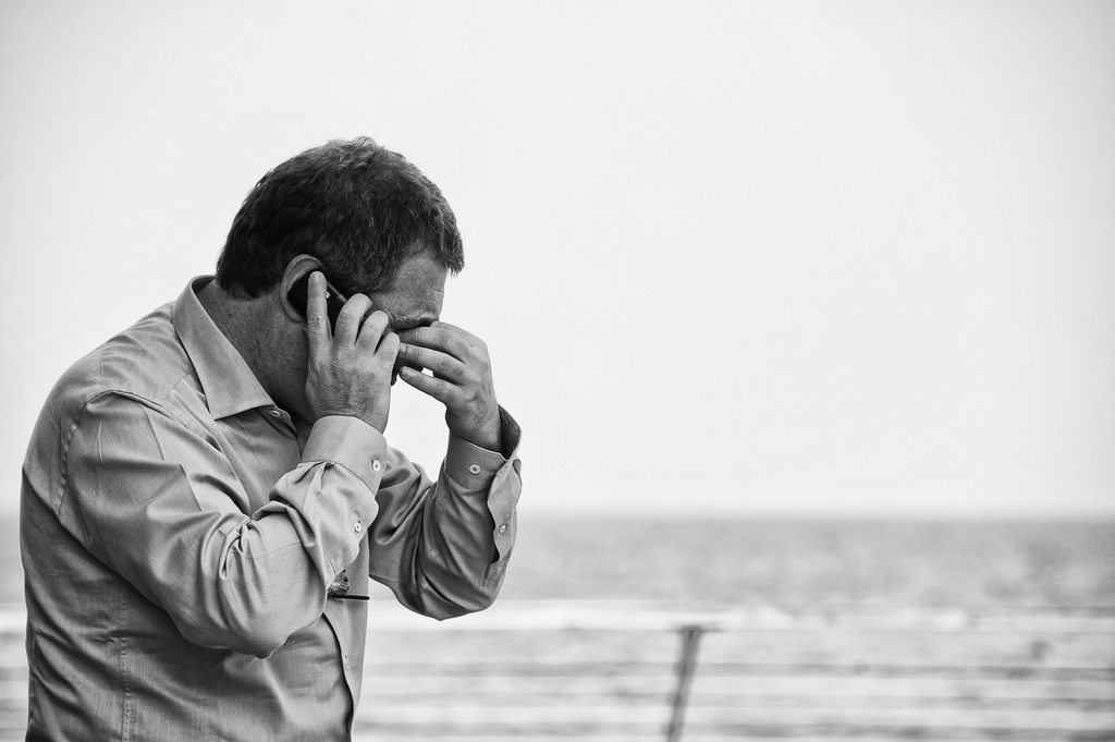 A worried man on the phone. Credit: photoloni/Flickr, CC BY 2.0