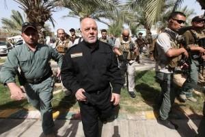 Iraq's Prime Minister Haider al-Abadi (front 2nd L) walks during his visit to an Iraqi army base in Camp Tariq near Falluja, Iraq, June 1, 2016. Credit: Reuters/Alaa Al-Marjani
