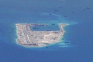 Chinese dredging vessels are purportedly seen in the waters around Fiery Cross Reef in the disputed Spratly Islands in the South China Sea in this still image from video taken by a P-8A Poseidon surveillance aircraft provided by the US Navy May 21, 2015. Credit: US Navy/Handout via Reuters/File Photo