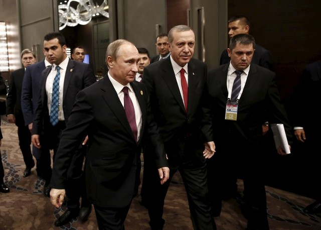 Turkey's President Tayyip Erdogan (2nd from right) walks with his Russian counterpart Vladimir Putin prior to their meeting at the Group of 20 (G20) leaders summit in the Mediterranean resort city of Antalya, Turkey, November 16, 2015. Credit: Reuters/Kayhan Ozer.