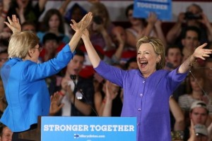 Democratic US presidential candidate Hillary Clinton (right) after being introduced by US Senator Elizabeth Warren at a campaign rally in Cincinnati, Ohio, U.S. June 27. Credit:Reuters/Aaron Josefczyk.