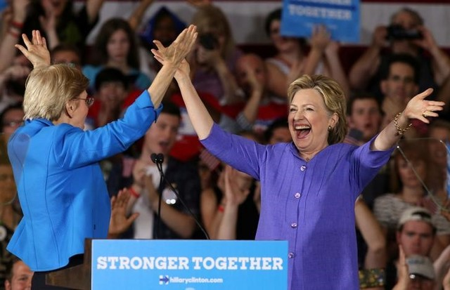 Democratic U.S. presidential candidate Hillary Clinton (right) after being introduced by US Senator Elizabeth Warren at a campaign rally in Cincinnati, Ohio, U.S. June 27. Credit:Reuters/Aaron Josefczyk.