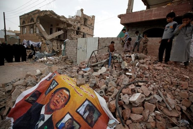 A defaced poster of the UN Secretary-General Ban Ki-moon is seen on the rubble of a house during a vigil marking one year since a Saudi-led air strike on a residential area in Sanaa, Yemen June 2. Credit: Reuters, /Khaled Abdullah