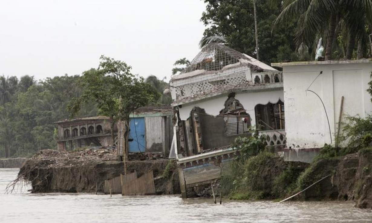 Worsening erosion of brahmaputra 39 s banks uproots for Bangladesh house picture