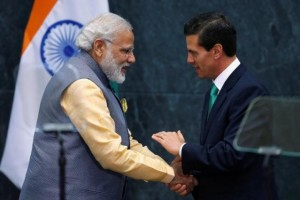 India's Prime Minister Narendra Modi shakes hands with Mexican President Enrique Pena Nieto after they gave a speech, at Los Pinos presidential residence in Mexico City, Mexico, June 8, 2016. Credit: Reuters/Edgard Garrido