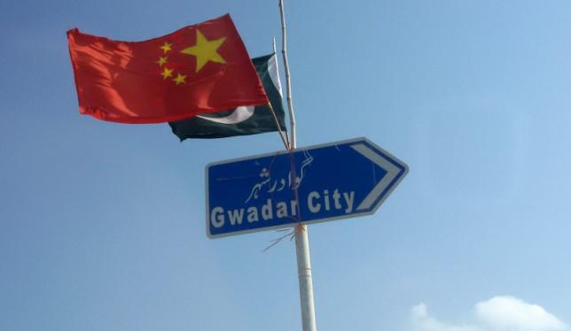 The Chinese and Pakistani flags fly on a sign along a road towards Gwadar, Pakistan January 26, 2016. Picture taken January 26, 2016. Credit: Reuters/Syed Raza Hassan