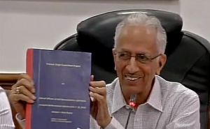 Prakash Singh with the report. Credit: ANI/Twitter