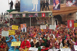 Women followers sheild the Satlok Ashram of Sant Ram Pal in Hisar after the news of police approaching it in November, 2015. Credit: PTI