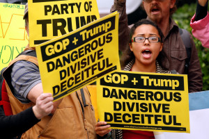 Protesters shout outside the Republican National Committee on Capitol Hill in Washington, May 12, 2016. Credit: Reuters/Kevin Lamarque