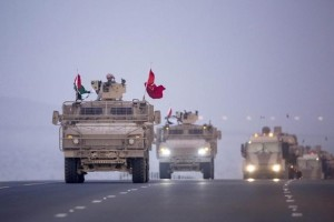 Members of the UAE armed forces travel in military vehicles as the first batch of UAE military personnel returns from Yemen in Abu Dhabi, November 7, 2015. Credit: Reuters/United Arab Emirates News Agency WAM