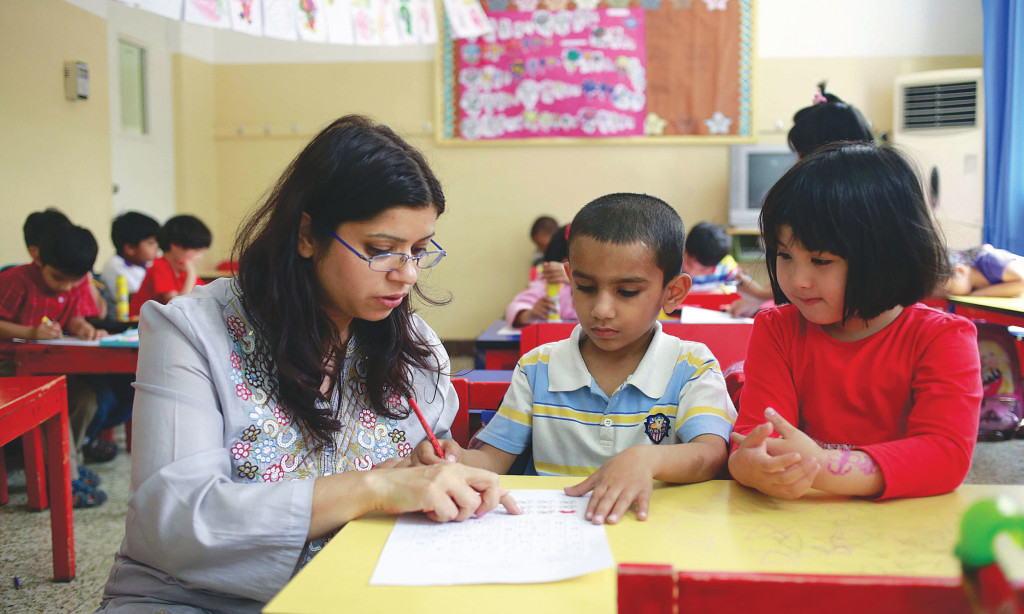A teacher at the Pakistan Embassy College in Beijing with students. Credit: China Daily Images.