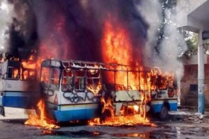 A bus set ablaze by a mob during the Jat reservation agitation in Haryana. Credit: PTI