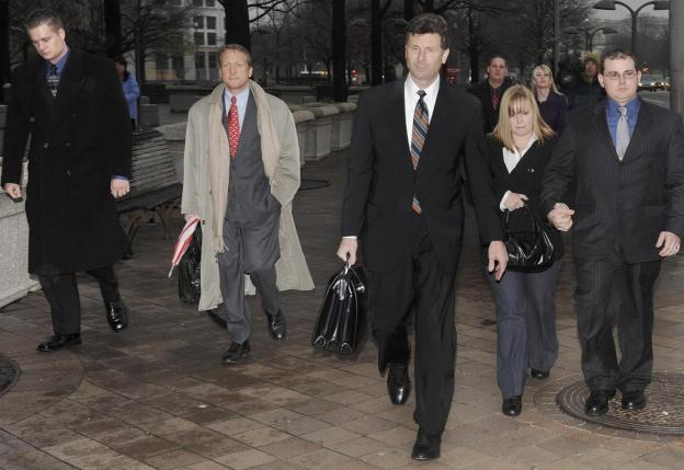 Blackwater Worldwide security guards Evan Liberty (L) and Dustin Heard (R) leave the federal courthouse with their legal team and supporters after being arraigned with three fellow Blackwater guards on manslaughter charges in a 2007 shooting incident in Baghdad, in Washington in this January 6, 2009 file photo. Credit: Reuters/Jonathan Ernst/Files