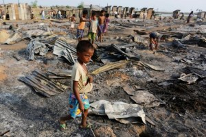A boy walks among debris after fire destroyed shelters at a camp for internally displaced Rohingya Muslims in the western Rakhine State near Sittwe, Myanmar, May 3, 2016. Credit: Reuters/Soe Zeya Tun