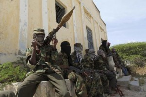 Al Shabaab soldiers sit outside a building during patrol along the streets of Dayniile district in Southern Mogadishu, March 5, 2012. Credit: Reuters/Feisal Omar