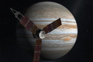 An artist's illustration of Juno, with Jupiter in the background. Credit: NASA/JPL-Caltech