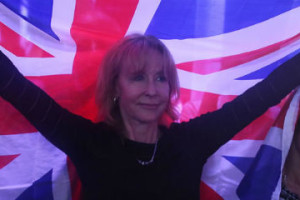 A Brexit supporter holds a Union Flag at a Vote Leave rally in London. Credit:Reuters