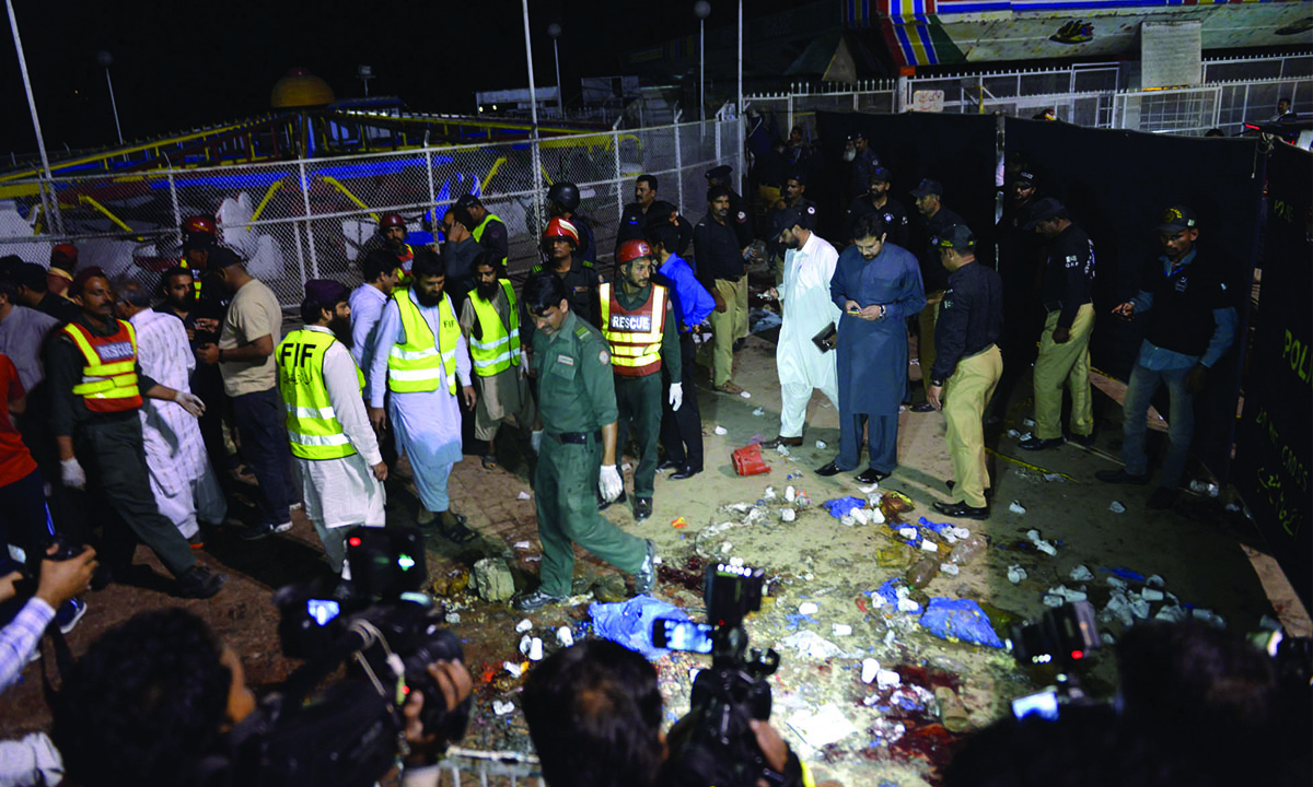 Rescue workers, officials and journalists gather at a bomb blast site in Lahore on March 27, 2016 Credit: M. Arif, White Star