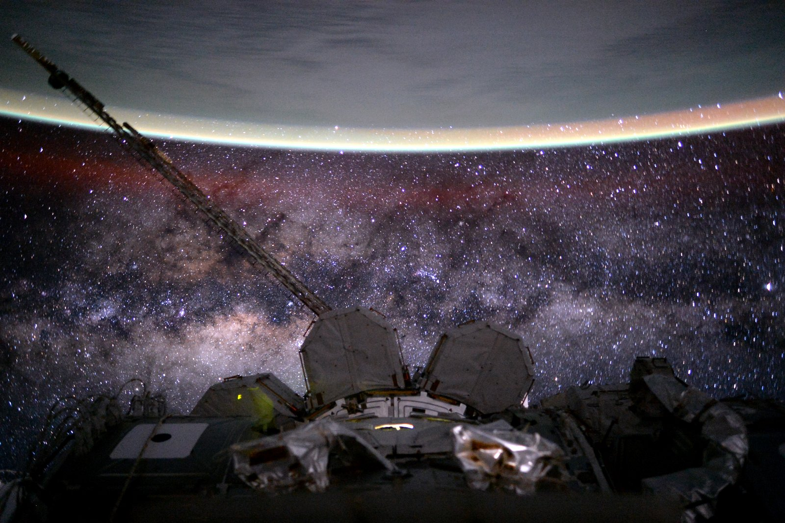 The central band of the Milky Way as seen from the ISS. Earth is visible on top. Credit: Scott Kelly/NASA