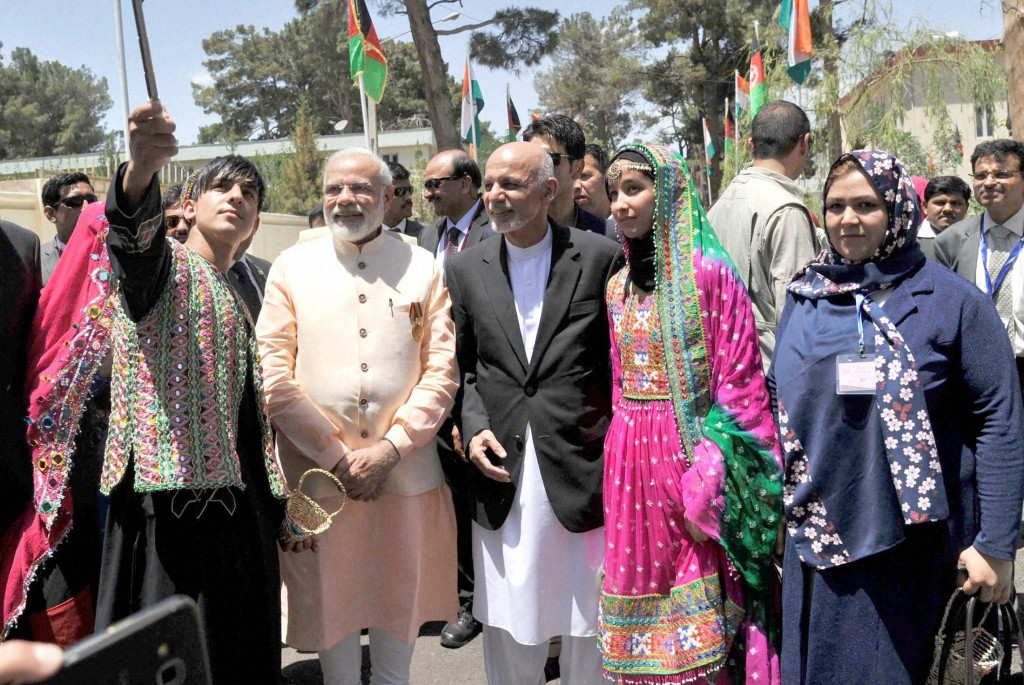 Prime Minister Narendra Modi and the President of Afghanistan, Mohammad Ashraf Ghani, in a group photograph in Herat, Afghanistan on Saturday. Credit: PTI