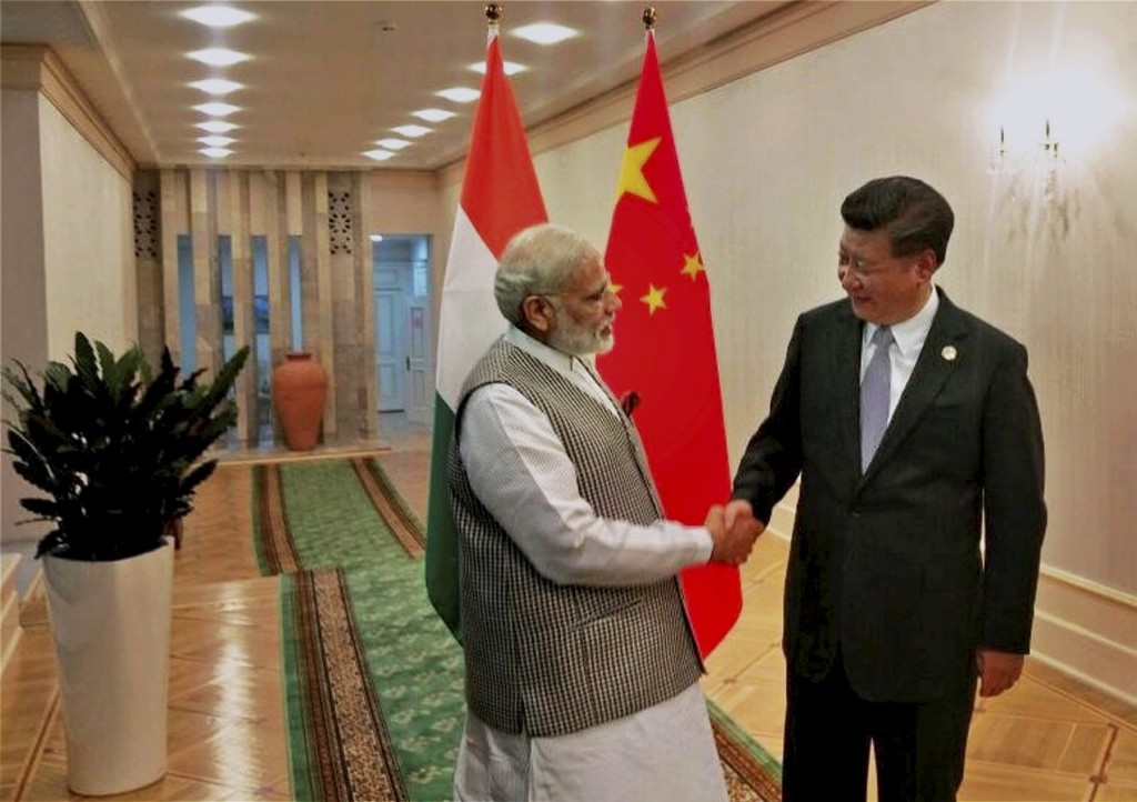 Prime Minister Narendra Modi shakes hands with Chinese President Xi Jinping before their meeting in Tashkent on Thursday on the sidelines of the SCO summit. Credit: PTI