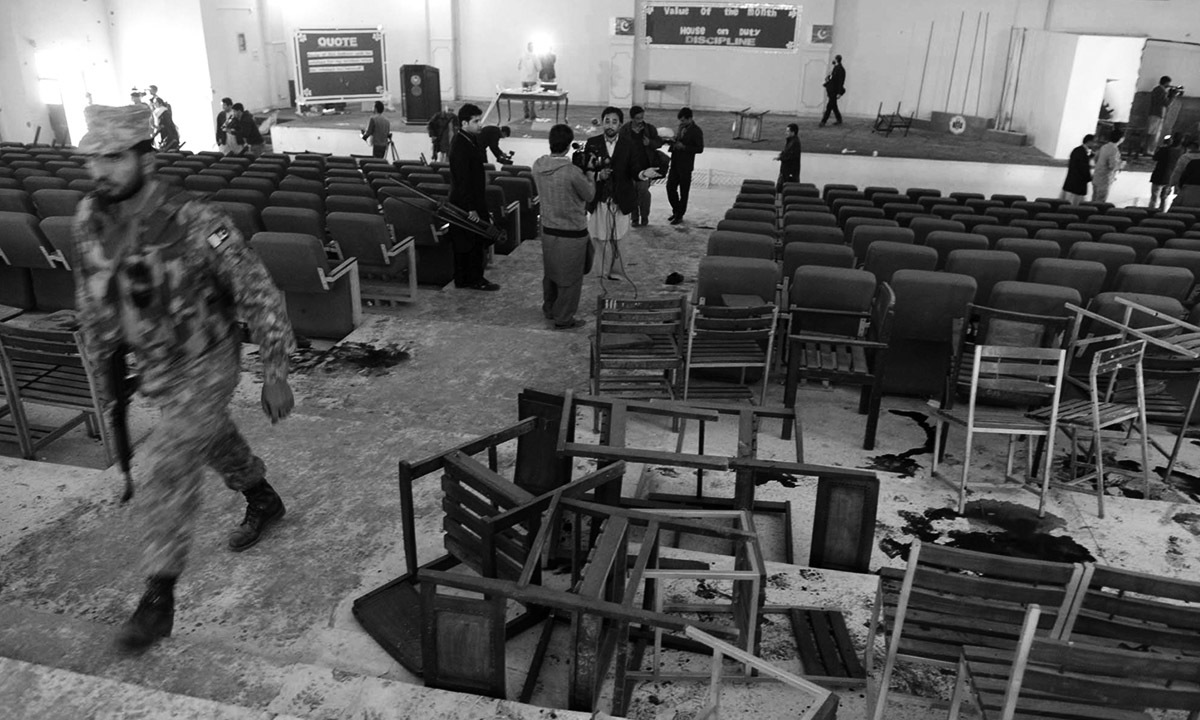 Journalists gather in the auditorium of the Army Public School in Peshawar after the massacre on 16 December, 2014. Credit: Abdul Majeed Goraya, White Star.
