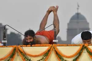 Yoga exponent Ramdev and his aide Bal Kishan at a yoga camp ahead of International Yoga Day on June 21, at Rajpath in New Delhi on Sunday. Credit: PTI/Vijay Verma (PTI6_19_2016_000209A)