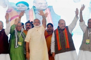 Prime Minister Narendra Modi with Union Minister Rajnath Singh, BJP president Amit Shah and other senior leaders during the 'Parivartan Rally' at Parade Ground in Allahabad on Monday. Credit: PTI