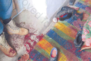 A photograph taken by military investigators in the room where members of an Afghan family were killed near Gardez in Afghanistan's Paktia province, Feb. 12, 2010.